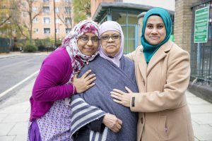 Three Bangladeshi women in winter coats and headscarves
