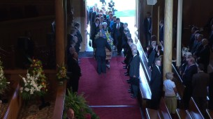 President Packer's family enters the Tabernacle.