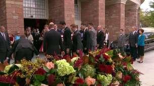 Pall bearers carry Elder Scott's casket to the hearse.