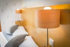 Tête de lit en chambre prestige à l'hôtel le Chalet près l'Andorre