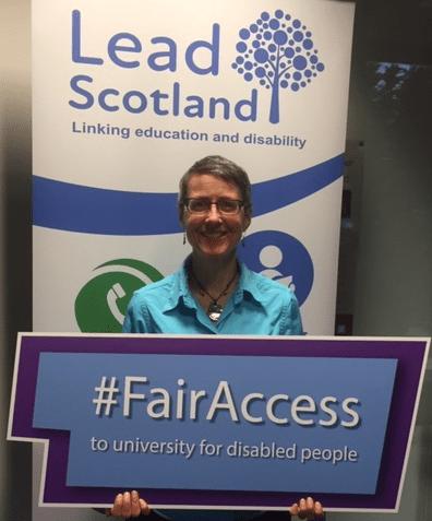 Emma Whitelock, CEO Lead Scotland holding the #FairAccess campaign banner