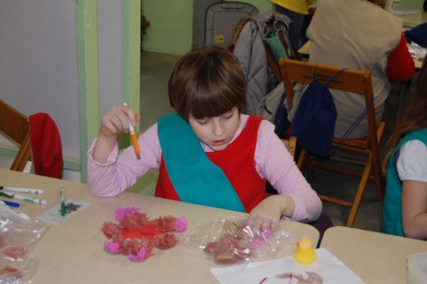 girl making teddy bear craft for valentines day