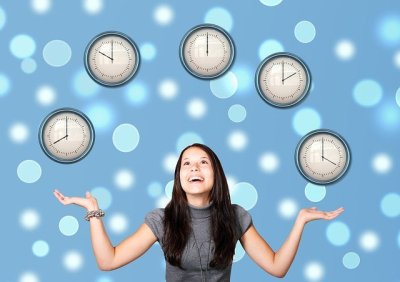 Woman Juggling clocks in the air