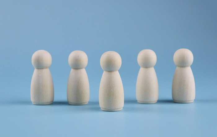 pawns with one in front of the others showing leadership