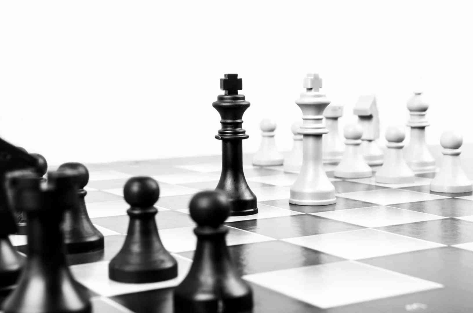 Chess board with black and white kings facing eachother