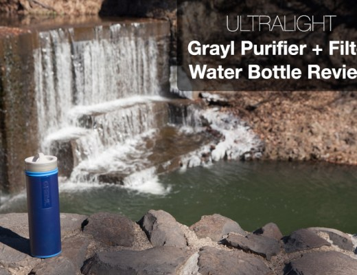 Reusable water bottle on cliff above waterfall