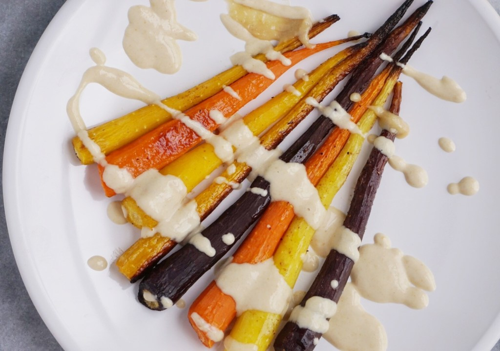 Roasted Rainbow Carrots with a Maple Tahini Sauce5 1024x719 - Roasted Rainbow Carrots with a Maple Tahini Sauce