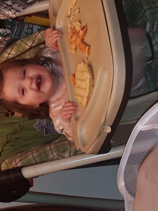 happy baby eating at grandparents' house