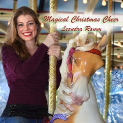 Leandra Ramm picture, wearing dark purple shirt sitting on a merry go round for Magical Christmas Cheer Album Cover