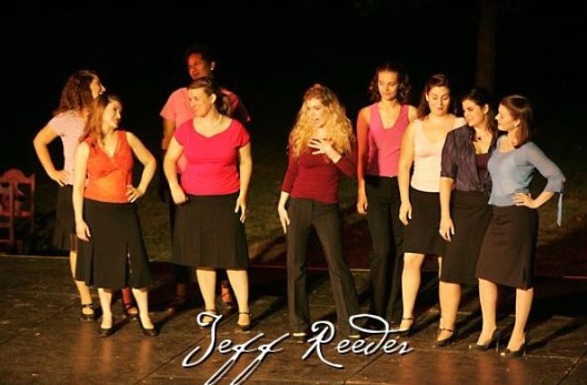 Leandra Ramm picture, wearing red shirt and brown pants in Jeff Reeves play