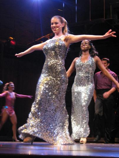 Leandra Ramm picture, singing and wearing sparkling silver dress