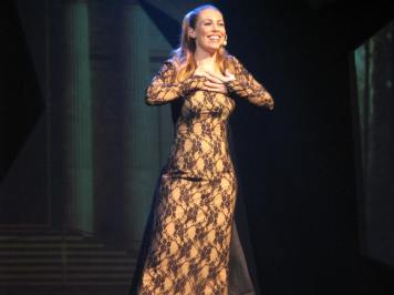 Leandra Ramm picture, singing and wearing light brown textured dress Take One