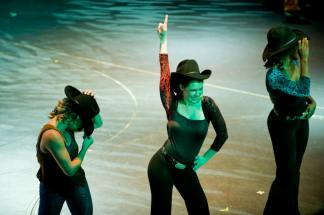 Leandra Ramm picture, dancing and wearing a cowboy hat and black dress and pants