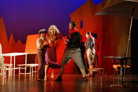 Leandra Ramm picture, wearing a purple dress in a drama play Take Three