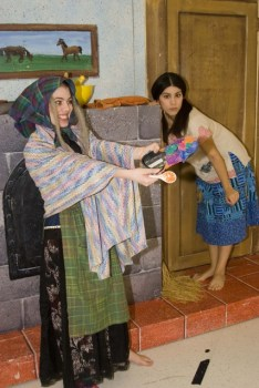 Leandra Ramm picture, wearing multiple clothing and scarf in a play