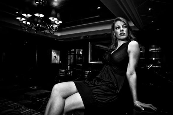 Leandra Ramm black & white picture, wearing black dress sitting down Take Two
