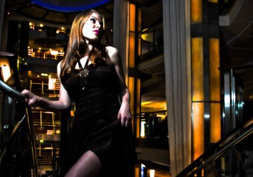 Leandra Ramm picture, wearing black dress, on staircase