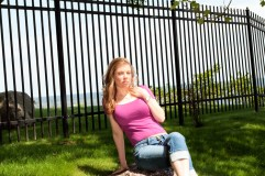 Leandra Ramm picture, wearing pink shirt sitting down on a rock outdoor Take Two