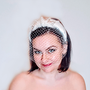 Bridal satin and beaded Headband model looking forward and smiling