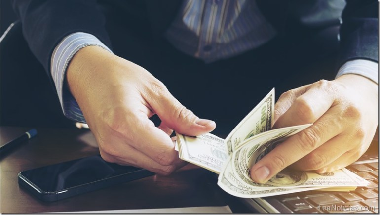 Business man counting dollar banknote - online business concept