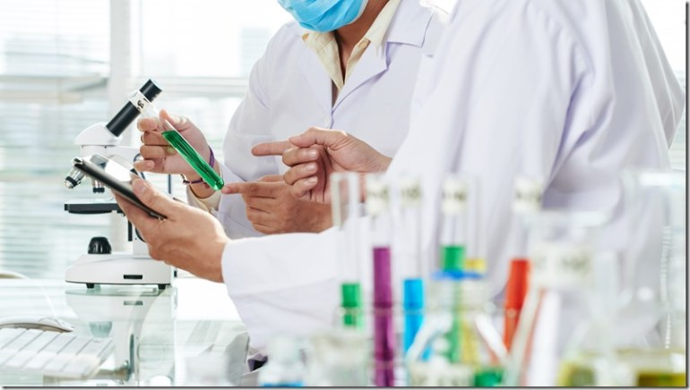 Chemists Carrying out Experiment