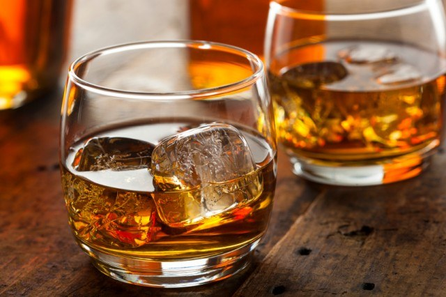 alcoholic-whiskey-bourbon-in-a-glass-with-ice-640x426