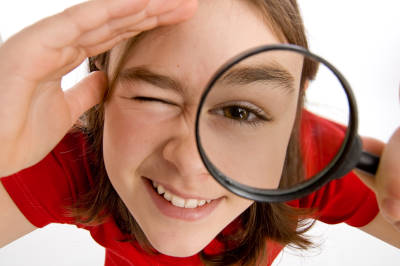 Girl holding magnifying glass