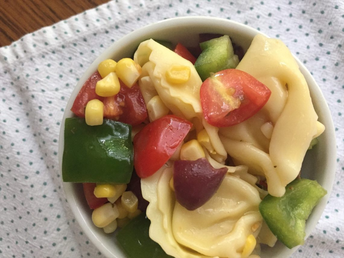 This easy and healthy vegetarian tortellini salad is loaded with vegetables like fresh summer corn, bell pepper, tomatoes, and more!