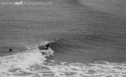 Shaun Kerslake weaves a top turn, the light was very flat on this overcast evening, this was shot with the bottom focus point active to try and get the sweeping line of swell in the shot.
