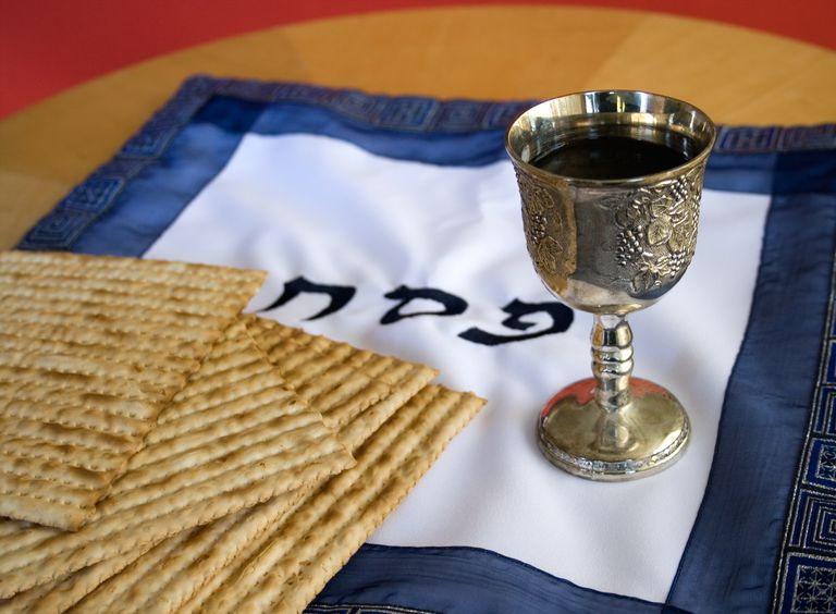 Various Passover items on wooden table