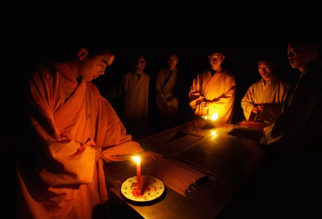 Velas da luz de Monges de Shaolin