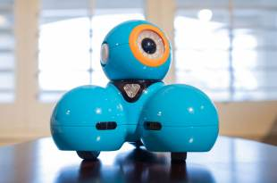 Dash Robot on a table with his eye looking up and to the right