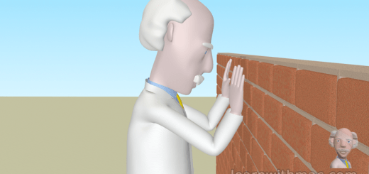 Professor Mac is standing facing an orange coloured wall with his hands resting on the wall directly in front of his face