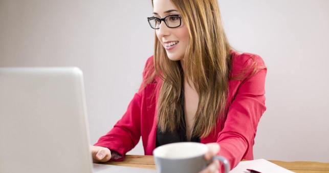 woman edupreneur working on laptop