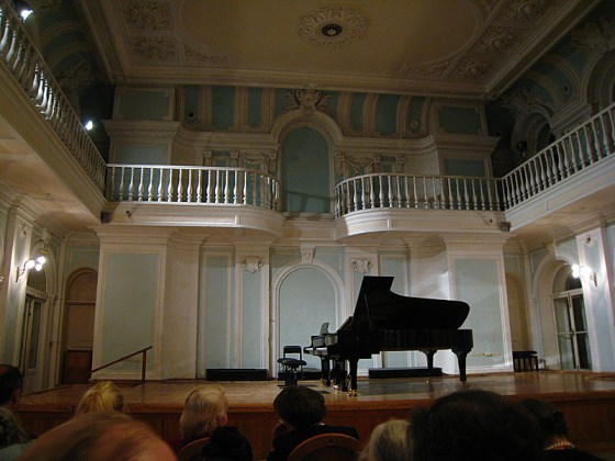 The recital was exceptionally long and the first pianist was absurd. She was amazingly full of herself, and I couldn't help laughing as she repeatedly kept staring at the ceiling during the performance puckering her lips or something. To top it off her playing wasn't that great either.