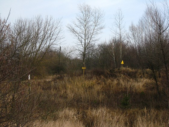 The yellow signs are where buildings have been buried because they were radioactive.