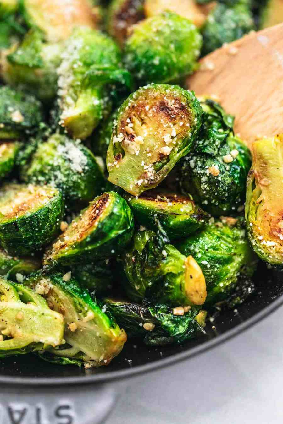 Sauteed Brussels Sprouts Recipe easy side dish with parmesan and garlic | lecremedelacrumb.com