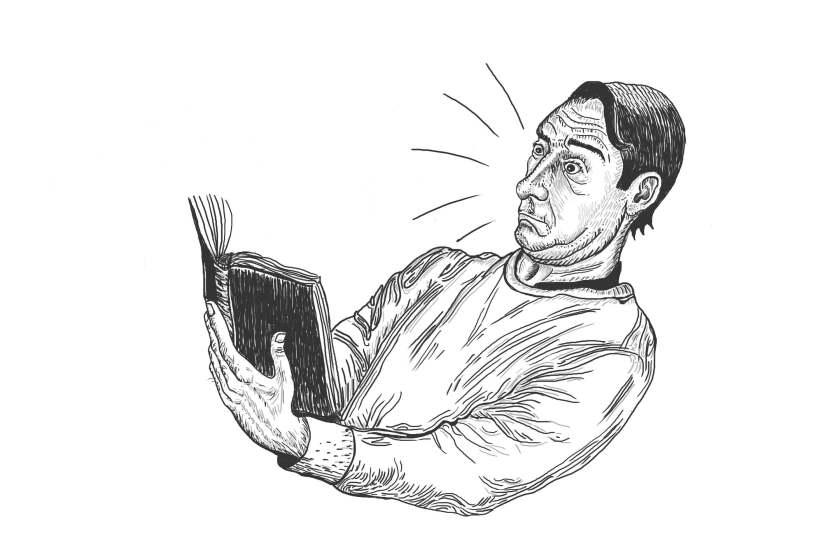Hombre leyendo sorprendido