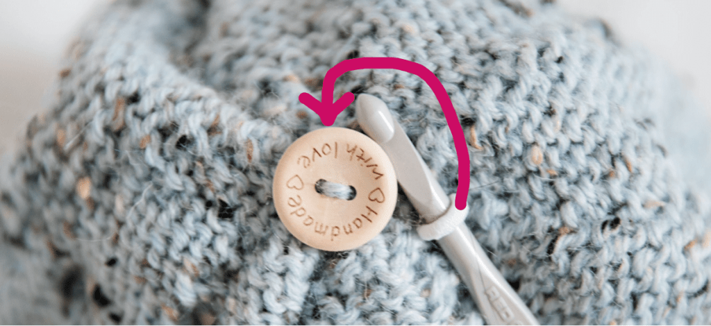 How to attach a pompom to a hat.