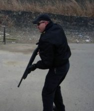 Officer using a shotgun
