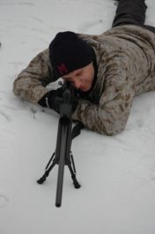 sniper using a rifle