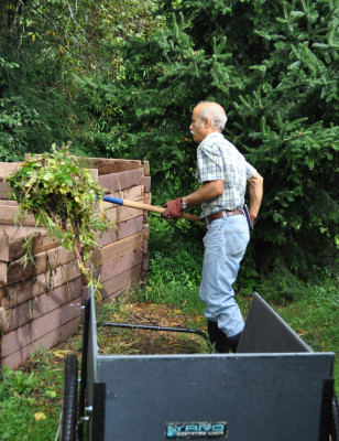 Organic materials feed compost pile.
