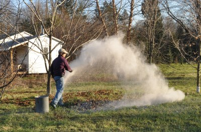 Spreading wood ash