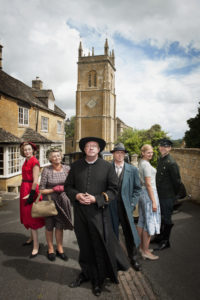 Programme Name: Father Brown - TX: n/a - Episode: n/a (No. n/a) - Embargoed for publication until: n/a - Picture Shows: L-R Lady Felicia (NANCY CARROLL), Mrs McCarthy (SORCHA CUSACK), Father Brown (MARK WILLIAMS), Inspector Valentine (HUGO SPEER), Susie (KASIA KOLECZEK), Sid (ALEX PRICE) - (C) BBC - Photographer: Des Willie