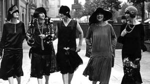 Five young women in the 1920s wearing 'flapper' dresses.