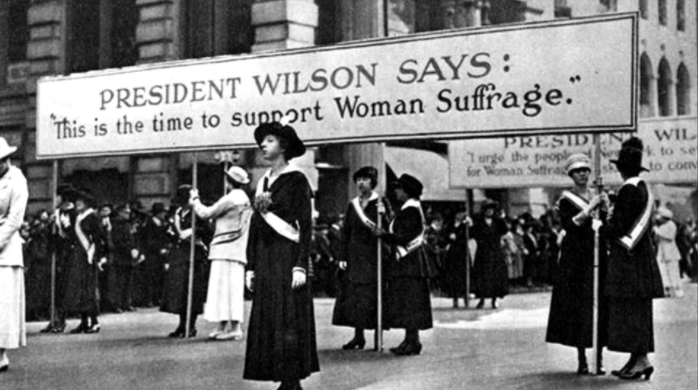 Women gathered at a women's suffrage movement in 1920s America