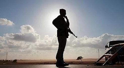 Un rebelle à Benghazi, jeudi. Opposés de longue date au régime de Kadhafi, Darnah et Benghazi sont en fait des bastions de l'islamisme radical.