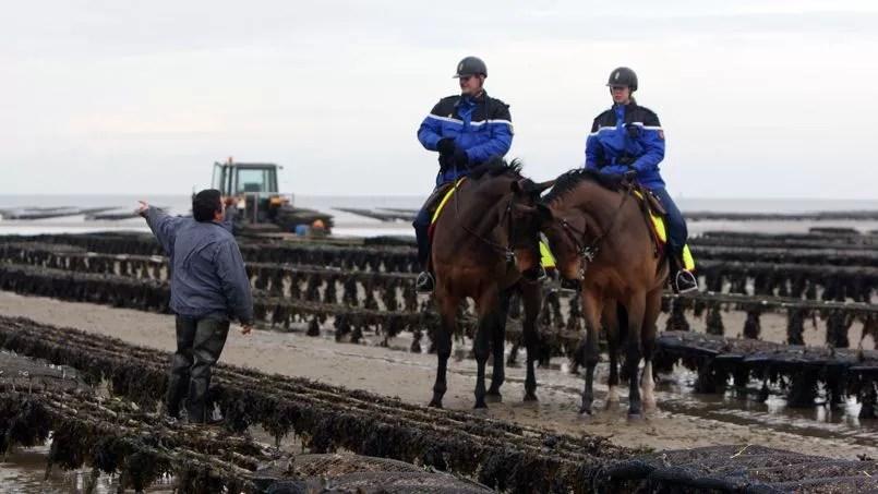 La garde républicaine, à Grandcamp-Maisy, dans le Calvados, en 2010.