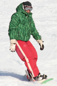 Solid colours and different patterns on snowboarder