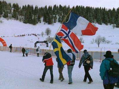 A man with three flags